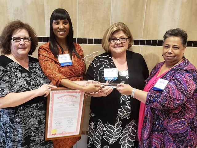 Kathryn Boles with Pam Moore, Loraine Travis (RSVP Manager), and Yaushica Aubert (VAAA Operations Manager)